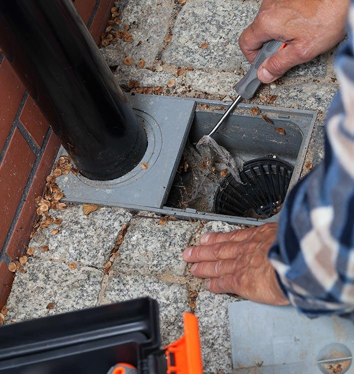 Specialist cleaning a blocked drain