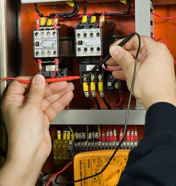 electrician fixing home's electrics